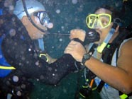 Image of 2 divers sharing air