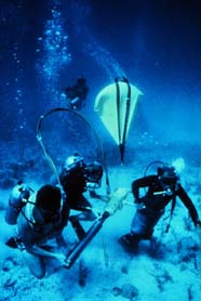 Scientists preparing to collect a core sample in a coral reef