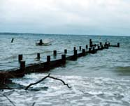 Image of tide swamping pier in storm